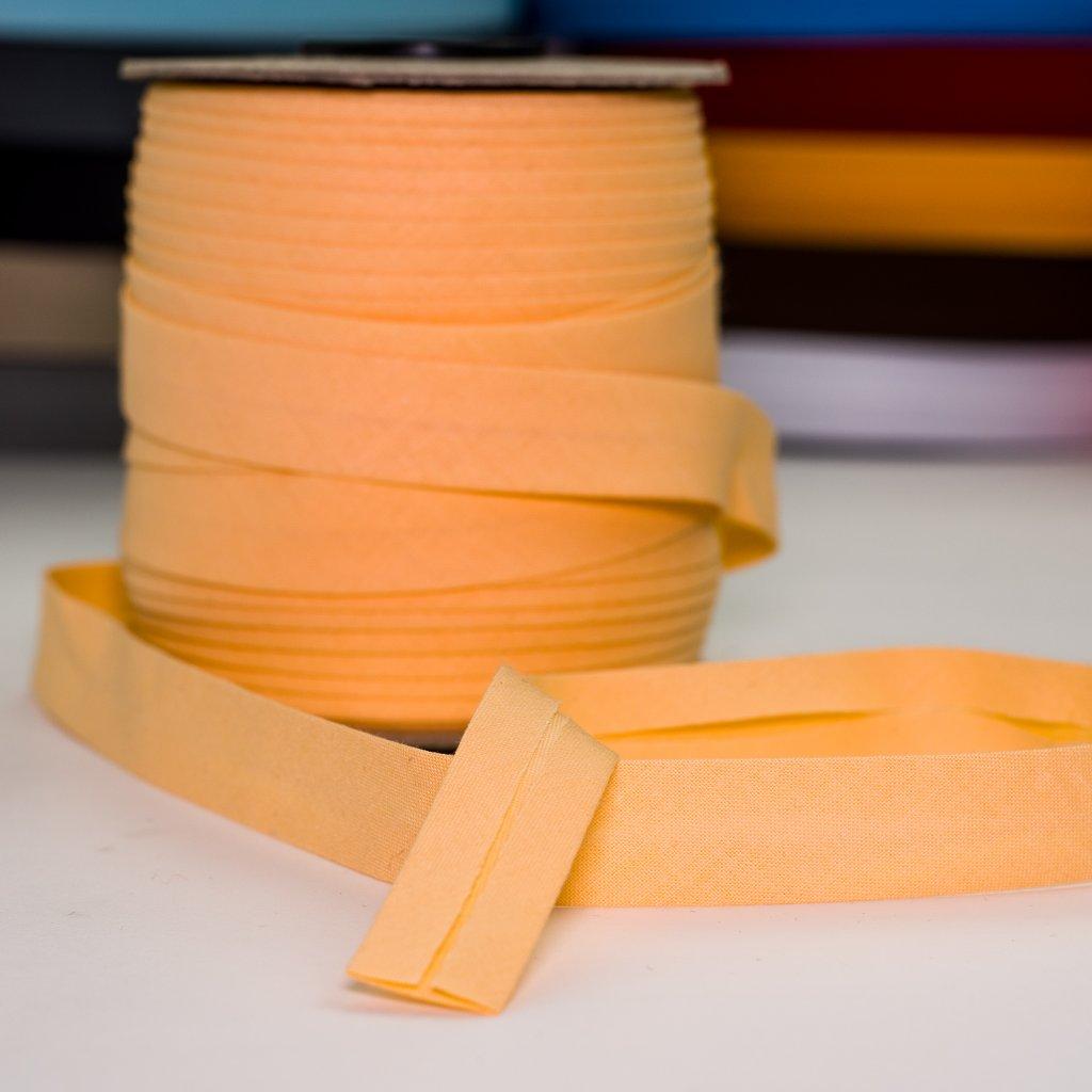 šikmý proužek lemovací bavlněný pomeranč