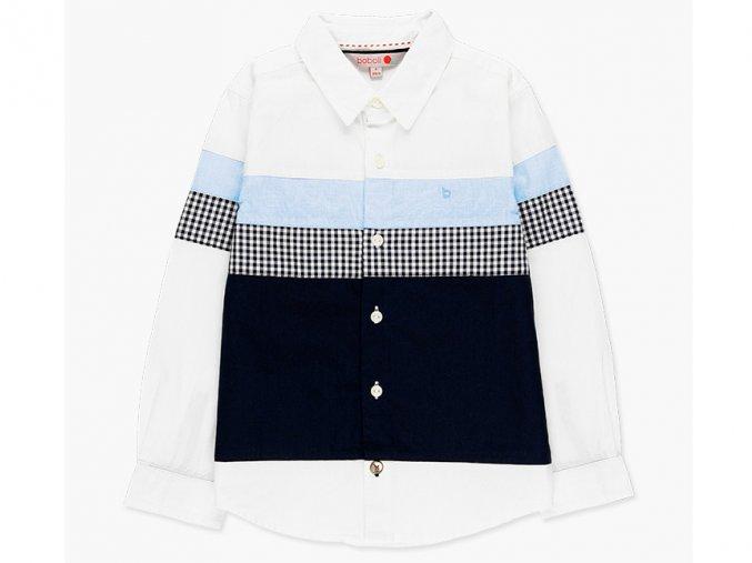 <p>Chlapecká košile ze sešitých barevně kontrastních látek ve světle a tmavě modré kombinaci s bílou ve velmi elegantním provedení. Art design.</p><p>Klasický knoflíkář.</p>