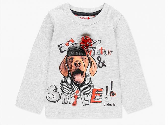 <p>Dívčí tričko s dlouhým rukávem z jemné bavlny, s potiskem usmívajícího se psa v zimní čepici, pruhované šále a s opravdovou bambulí.</p>