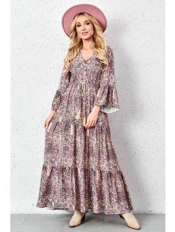 dluga wzorzysta sukienka z ozdobnym wiazaniem