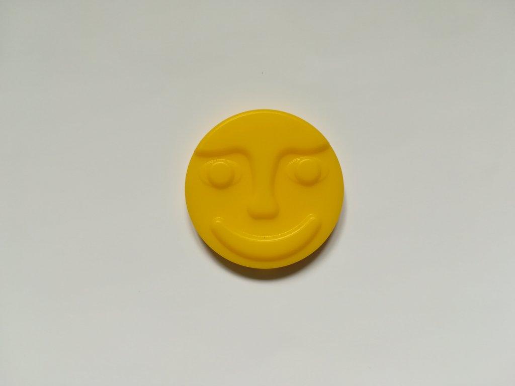 Žlutý střed s tváří