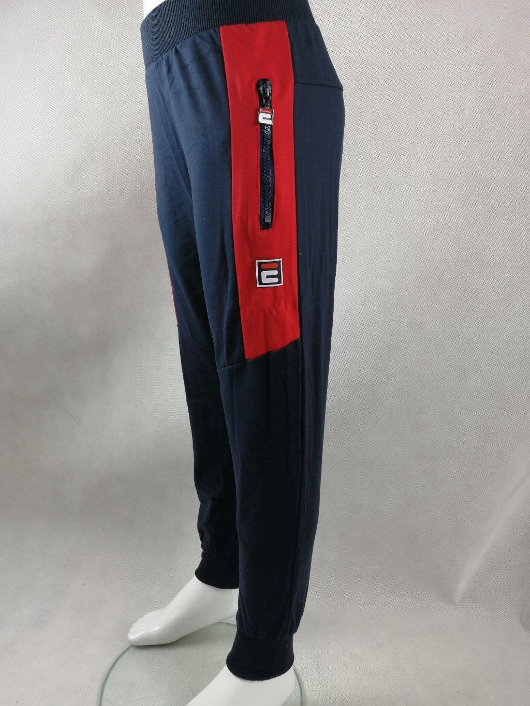 Chlapecké tepláky B-52406 s kapsami na zip