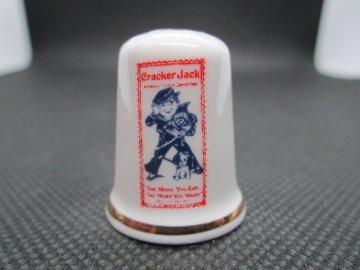 Sběratelský náprstek - Derby Thimbles England - Reklama Cracker Jack USA, popcorn a arašídy  s karamelem