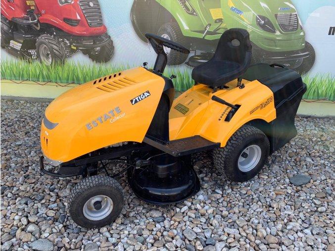 zahradní traktor stiga estate žluté barvy s velkými koly před plachtou traktory kolín