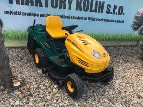 zahradní traktor yardman 18/105 zeleno-žluté barvy před plachtou traktory kolín