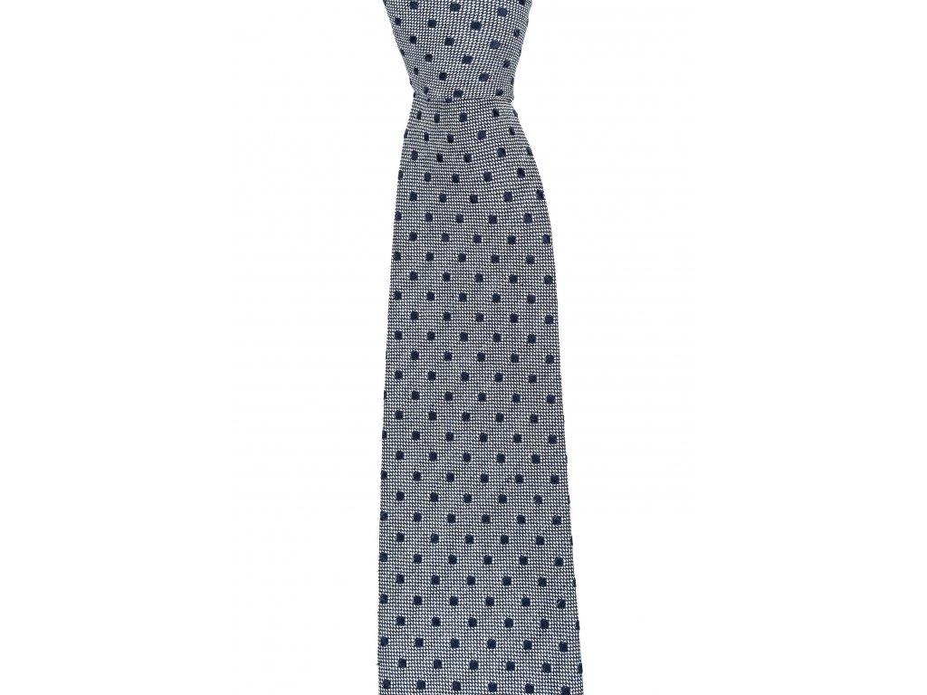 Šedá kravata s tmavě modrým puntíkem