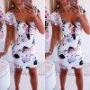 Bílé květované šaty s rafinovaným výstřihem