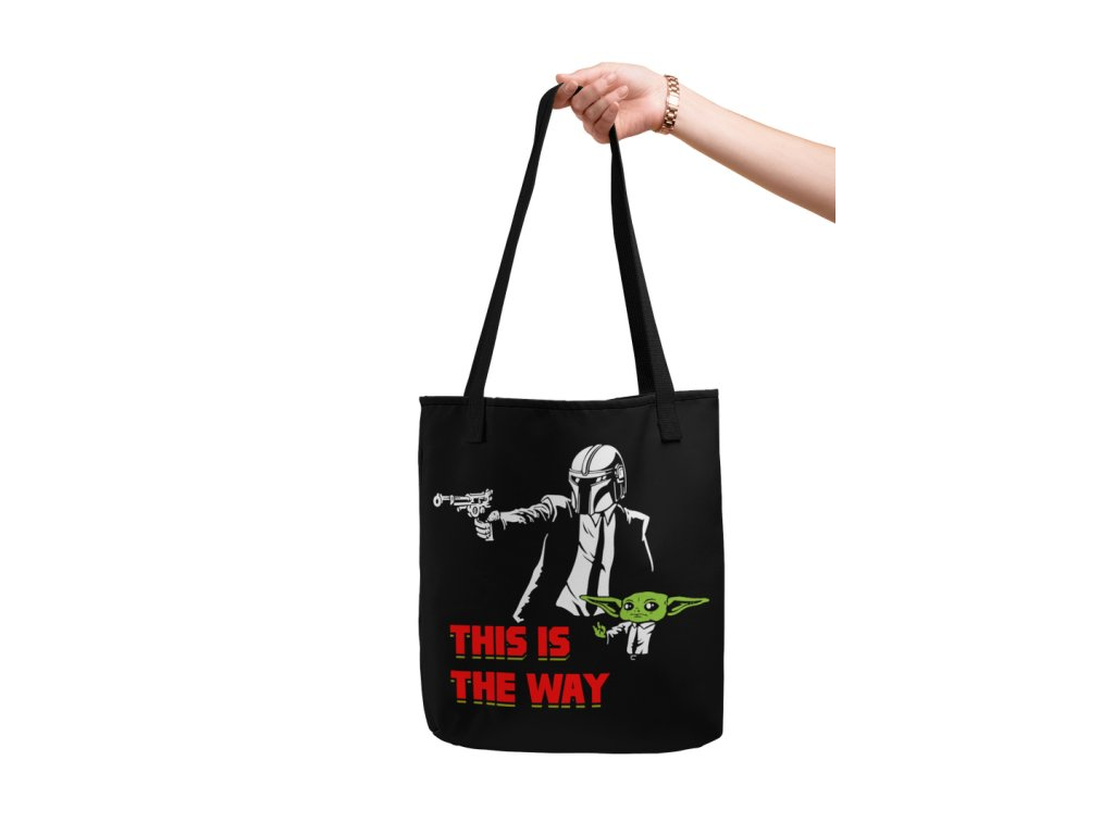 mockup of a hand holding a customizable strap tote bag against a flat surface 28832 min