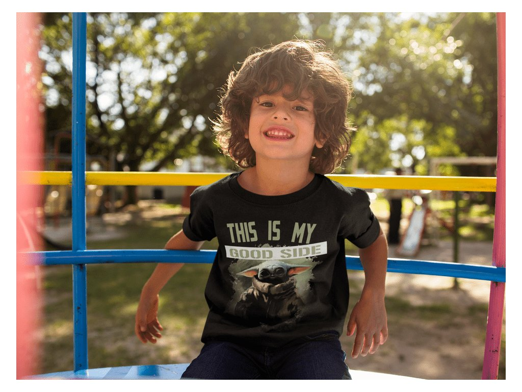 happy small boy wearing a t shirt mockup while at the park a17871 min