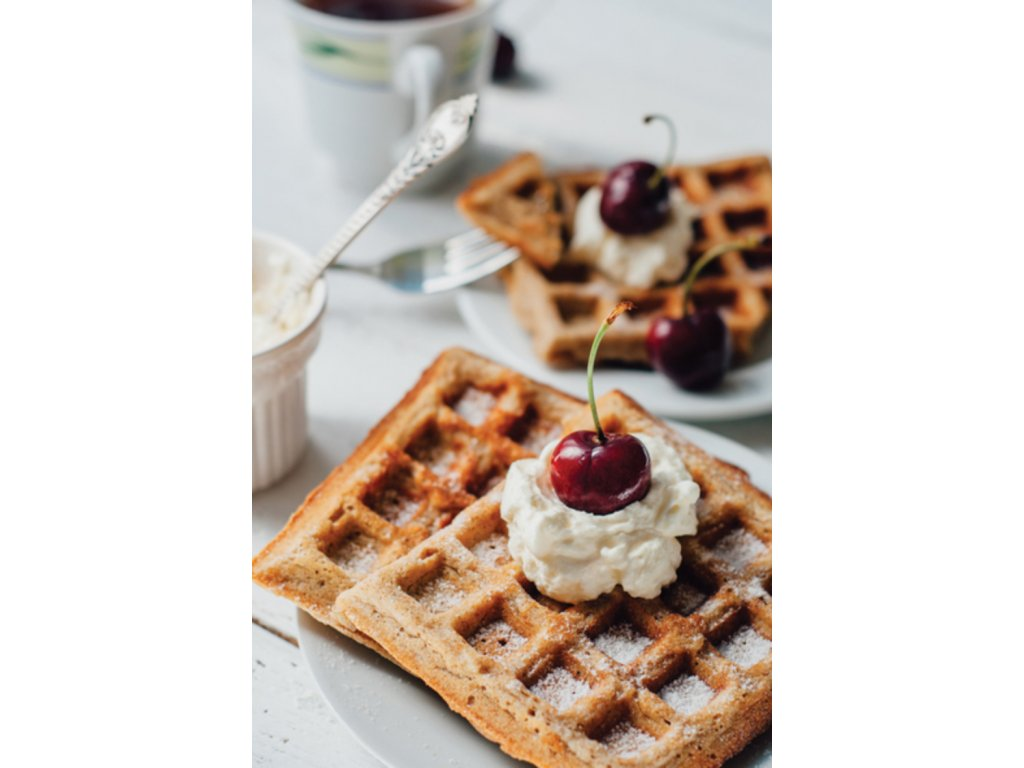 Postcard Waffles with whipped cream and cherry
