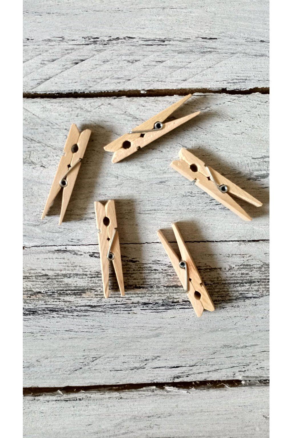 Dřevěné dekorační kulíčky velikosti 5 x 1 cm