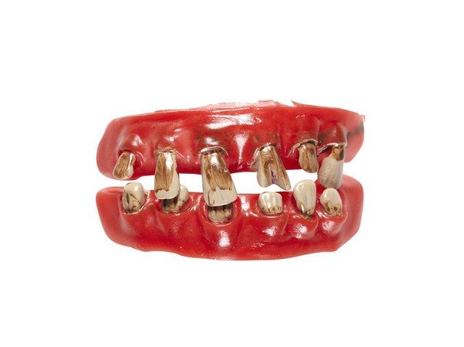 Gumové zuby křivé a zkažené