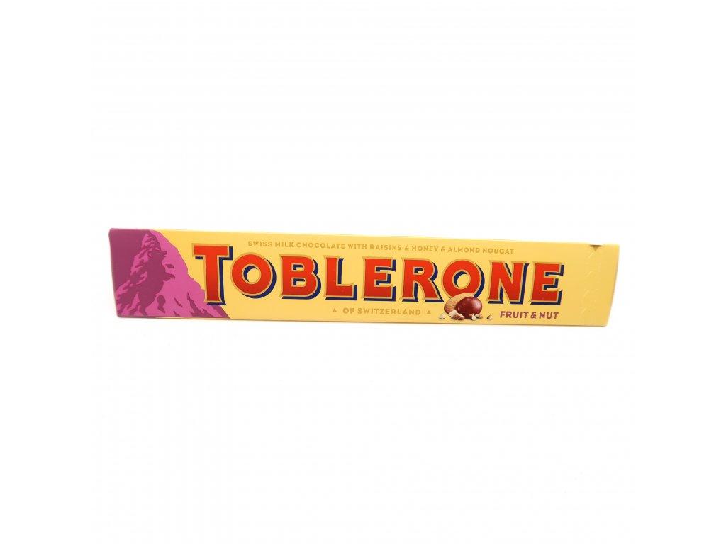 Toblerone Švýcarská mléčná čokoláda s rozinkami, medem a mandlovým nugátem - PEPIS.SHOP