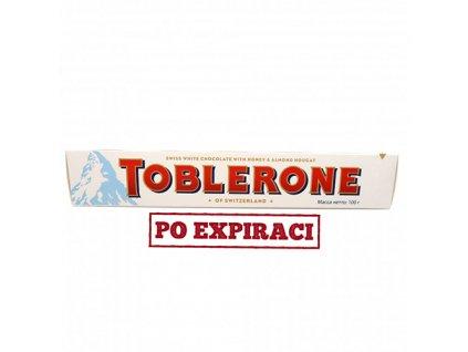 Po Expiraci Toblerone švýcarská bílá čokoláda s medem a mandlovým nugátem 100g CH