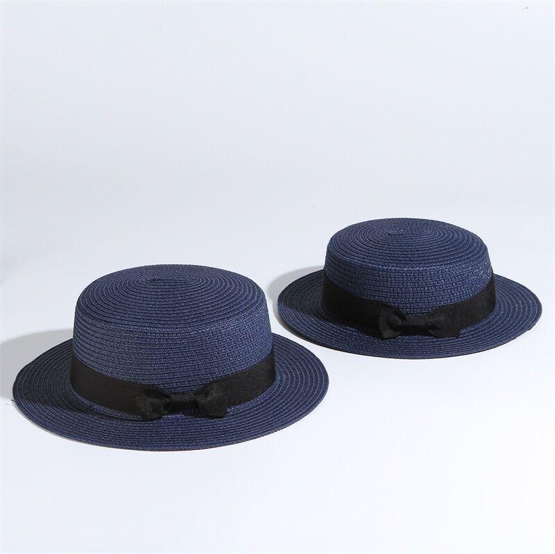 Dámský slaměný klobouk zdobený páskem s mašli Barva: Tmavě Modrá, Velikost: S
