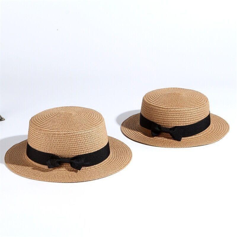 Dámský slaměný klobouk zdobený páskem s mašli Barva: Hnědá, Velikost: S