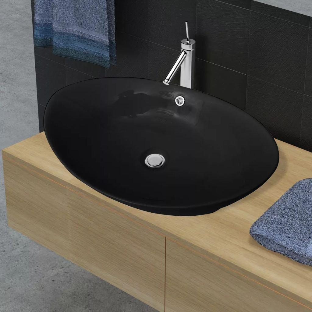 Černé luxusní keramické oválné umyvadlo s přepadem   59x38,5 cm