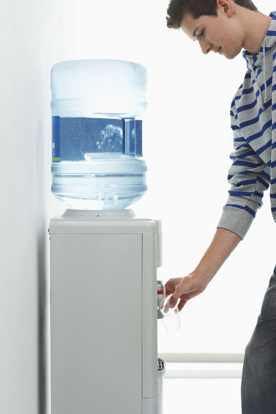 office-worker-using-water-cooler-80719448-58337ec45f9b58d5b1b9b5fa
