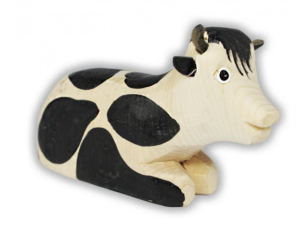 vyřezávaná kráva ležící