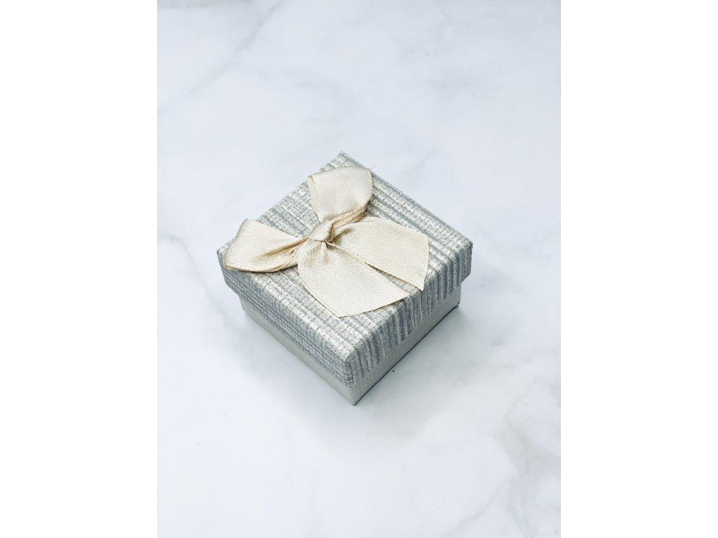 Darčeková krabička vzorovaná malá so zlatou mašľou