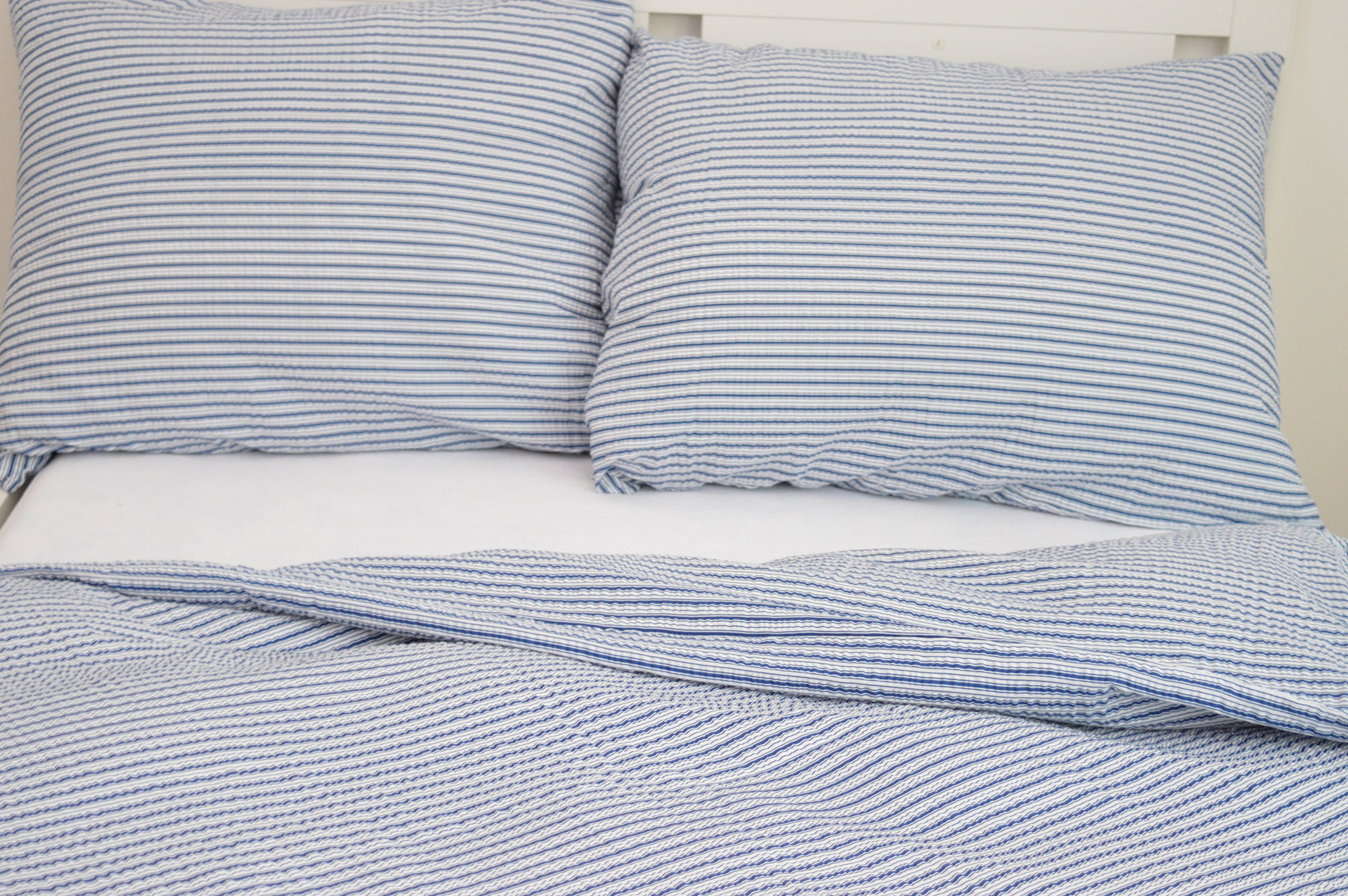 Krepový povlak na polštář  40x40 - Jemné proužky modré