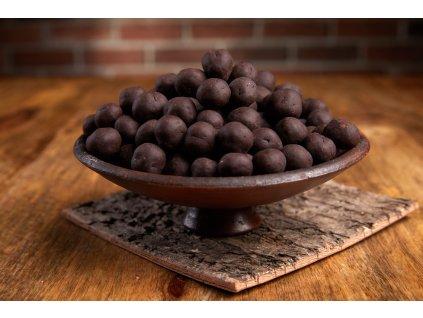 Lyofilizovaný černý rybíz v jemné krustě z 72% hořké čokolády