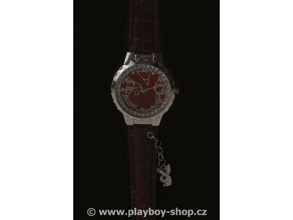 Fialové hodinky s velkým logem zajíce uvnitř ciferníku
