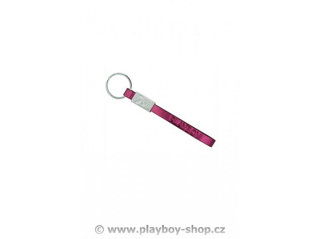 Nápis Playboy na růžovém koženém pásku