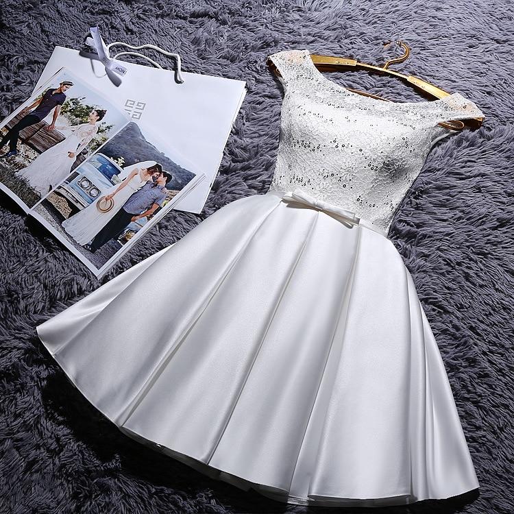 krátké bílé společenské šaty do tanečních Mina Barva: Bílá, Velikost: XS-S