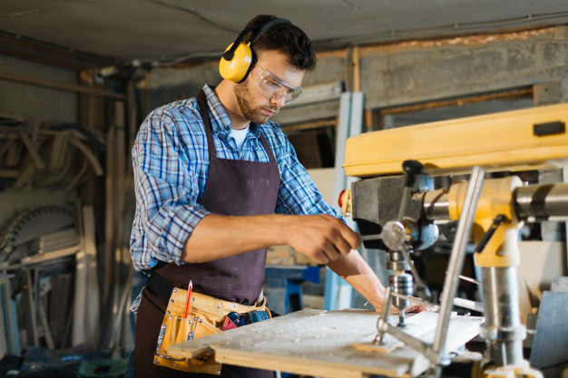 young-carpenter-focused-work_1098-13545