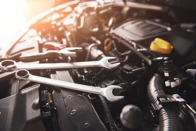 mechanic-hand-checking-fixing-broken-car-car-service-garage_146671-19718