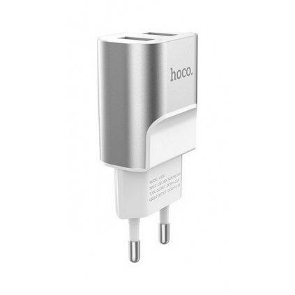 Cestovný adaptér HOCO C47A s funkciou rýchlonabíjania Dual 2.1A strieborno - biely