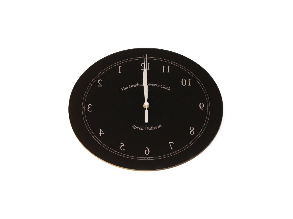 hodiny jdouci pozpatku ovalne