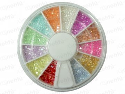 Farebné kamienky v karuseli - guľaté sklenené
