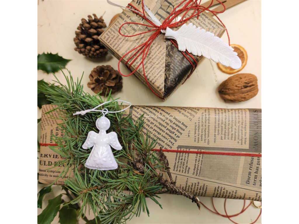 female hands tie string wrapped gift wooden desk