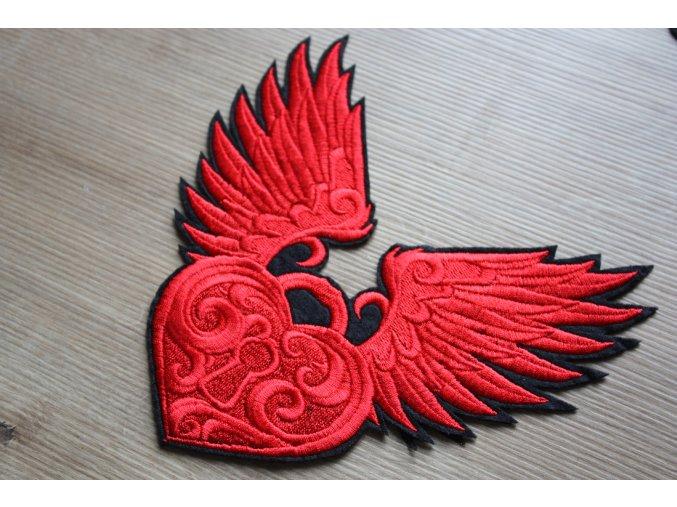 Červeno-černá aplikace ve tvaru zámku s křídly