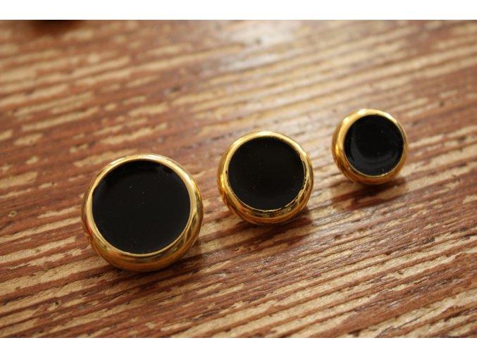 Zlatý knoflík s černým středem