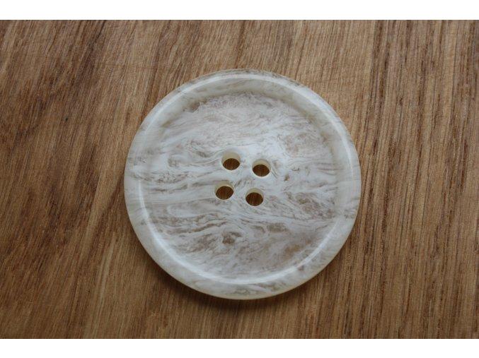 Knoflík se smetanovým melírem