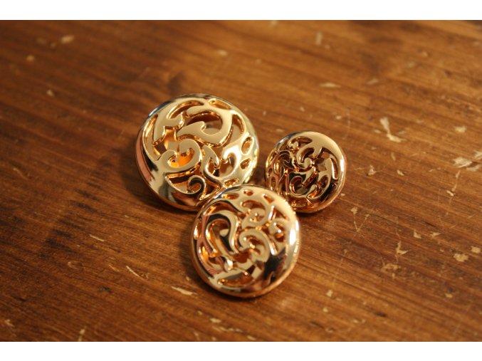 Zlatý knoflík s ornamentem