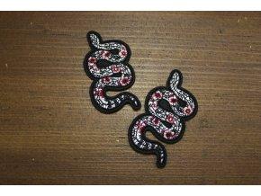 Menší aplikace ve tvaru hada, a la Gucci
