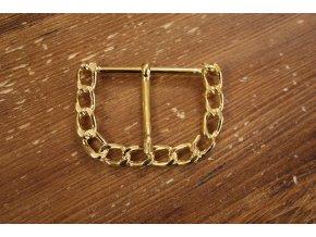 Zlatá spona Dolce & Gabbana.