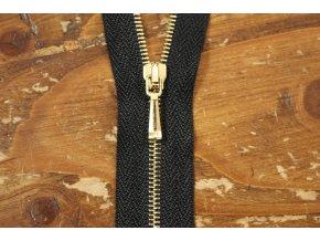 Černý zip se zlatým kovem,  50cm