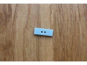 Plastový světle modrý obdélníkový knoflík