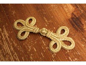 Zlaté textilní zapínání, čamara