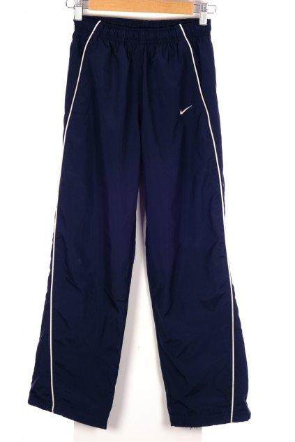 Kalhoty šusťáky Nike tmavě modré vel. 10 - 12 r / 140 - 152