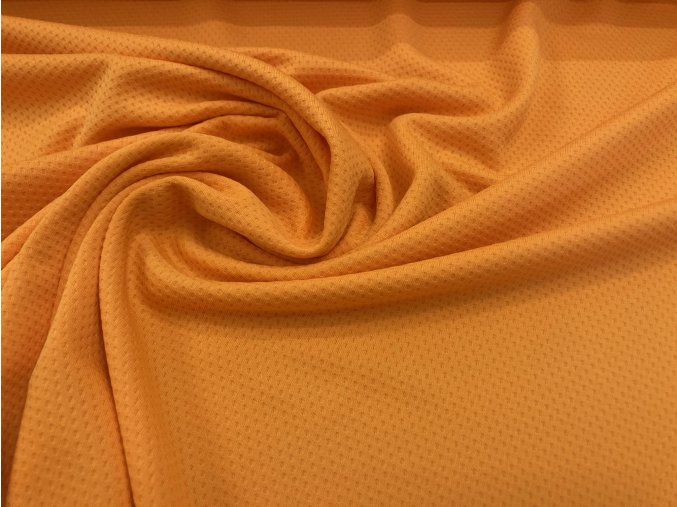 Úplet sportovní oranžový perforovaný