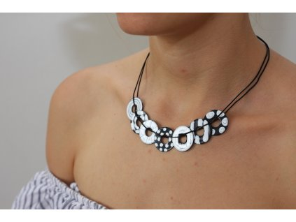black and white necklace on neck