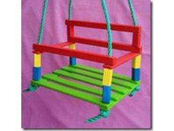 Houpačka dětská dřevo barevná 35x27 cm