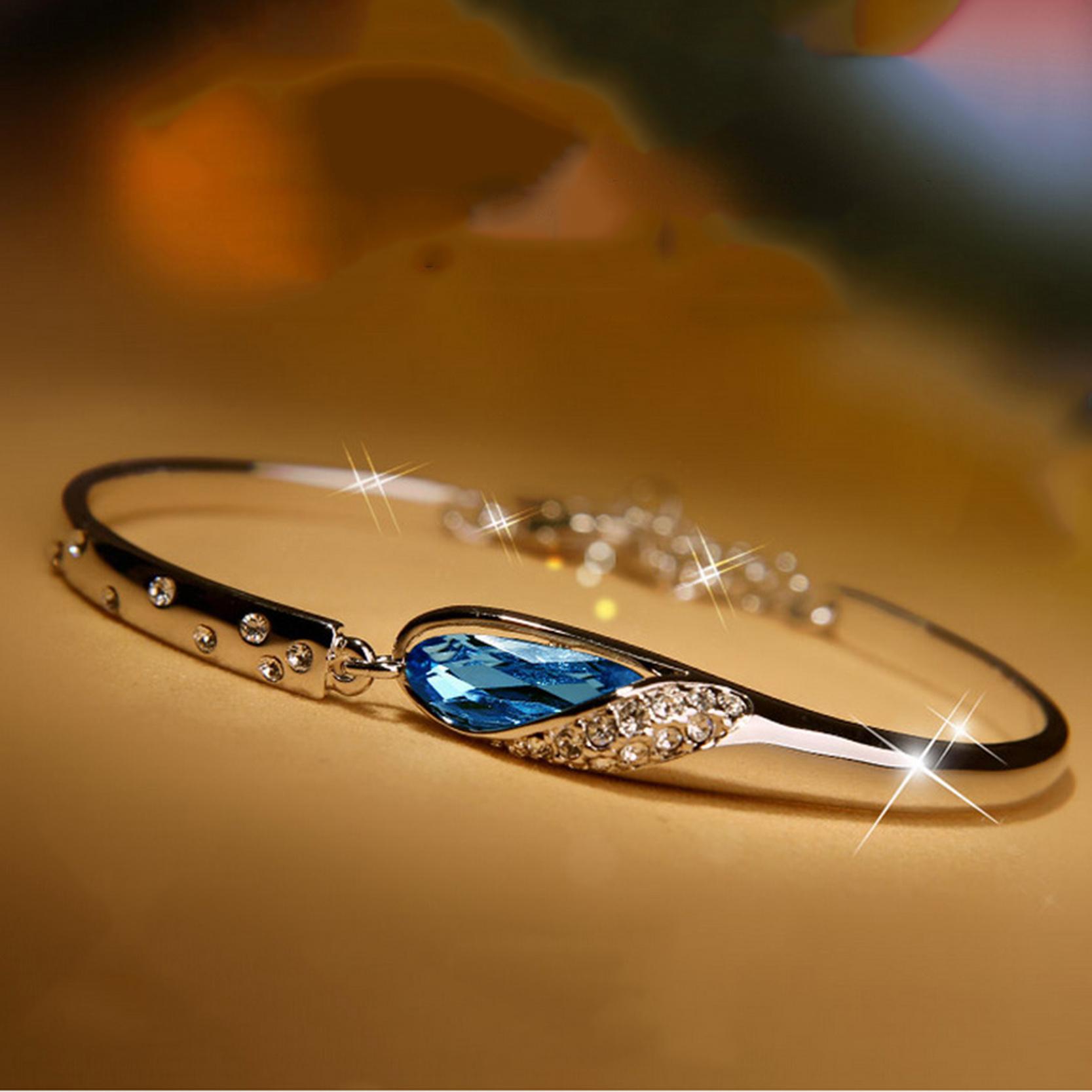 Originální půlený náramek s modrým krystalem
