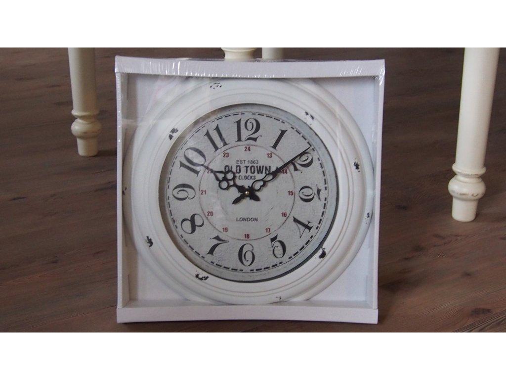 Bílé hodiny s patinou